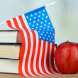 Stock Photo: Composition of American flag, books and apple on wooden table, on light background