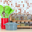 Stock Photo: Set of spices, tableware and kitchen utensils in kitchen on table on mosaic tiles background