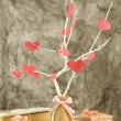Decorative branch with hearts, on grey background — Stock Photo #39504409