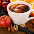 Fragrant mulled wine in bowl on wooden table close-up — Stock Photo