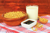 Soy products on table on wooden background — Stock Photo