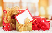 Gift boxes with blank label on carpet on bright background — Photo