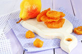 Dried pears on wooden background — 图库照片
