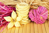 Decorative straw for hand made, flower and heart of straw, on wooden background — Stockfoto
