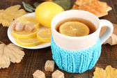 Cup of tea with lemon on wooden table — Stock Photo