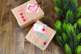 Paper gift boxes on wooden background — Foto Stock