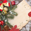 Frame with vintage paper and Christmas decorations on wooden background — Stockfoto