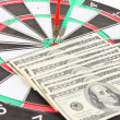 Dart on dartboard and money close up. Concept of success. — Stock Photo #39531833