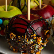 Stock Photo: Candied apples on sticks close up