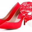 Stock Photo: Beautiful red female shoes and carnival mask, isolated on white