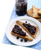 Delicious toast with jam on plate close-up — Stock Photo