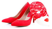 Beautiful red female shoes and carnival mask, isolated on white — Stock Photo