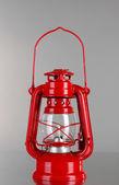 Red kerosene lamp on grey background — Stock Photo