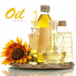 Stock Photo: Oil in jars and sunflower, isolated on white