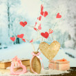 Decorative branch with hearts, on winter background — Stock Photo #39547491