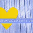 Paper hearts on blue wooden background — Stock Photo