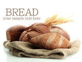 Tasty rye breads with ears, isolated on white — Foto Stock