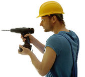 Young foreman with drill isolated on white — Foto de Stock