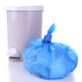 Garbage bin and plastic trash bag, isolated on white — Stock Photo
