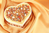 Beautiful hand made casket, on silk background — Stockfoto