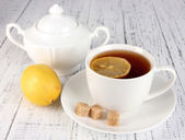 Cup of tea with lemon close up — Stock Photo