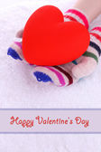 Female hands in mittens with heart on snow background — Foto Stock