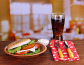 Tasty sandwich with cutlet, on color plate, on napkin, on bright background — Stock Photo