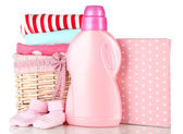 Softener dryer and washing powder with children clothes isolated on white — Stock Photo