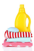 Softener dryer and soap on children clothes isolated on white — Stock Photo