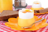 Boiled eggs in egg cups on table close-up — Stock Photo