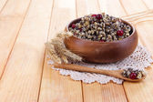 Plate with kutia - traditional Christmas sweet meal in Ukraine, Belarus and Poland, on wooden background — Stock Photo