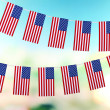 Garland of flags on bright background — Stock Photo #39583279