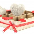 Hearts in wooden casket, isolated on white background — Stock Photo