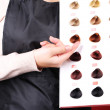 Hair stylist with hair samples of different colors, close-up — Stock Photo #39584121