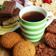 Stock Photo: Cup of tea and sweets close up