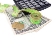 Tape measure with money and calculator close-up — Stock Photo