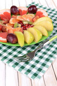 Sweet fresh fruits on plate on table close-up — Stockfoto