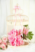 Beautiful decorative cage with beautiful flowers — Stock Photo