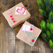 Paper gift boxes on wooden background — Stock Photo