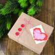 Paper gift box on wooden background — Stock Photo #39600077