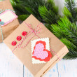 Paper gift box on wooden background — Stock Photo