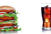 Huge burger and glass of cold drink, isolated on white — Stock Photo