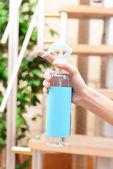 Sprayed air freshener in hand close-up — Stock Photo