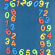 Colorful numbers on school desk background — Stock Photo