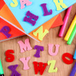 English alphabet, books and markers on wooden background — Stock Photo #39664205