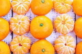 Ripe sweet tangerines on color wooden background — Stock Photo