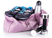 Sports bag with sports equipment isolated on white — Stock Photo
