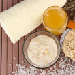 Stock Photo: Homemade facial mask with oats and honey,on color wooden background