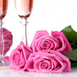 Stock Photo: Composition with pink sparkle wine in glasses, and pink roses isolated on white