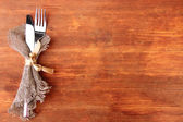 Spoon and fork on wooden table — Stockfoto